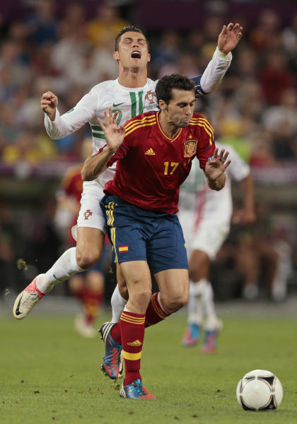 Spain's Alvaro Arbeloa, foreground, holds back Portugal's Cristiano Ronaldo during the Euro 2012 soccer championship semifinal match between Spain and Portugal in Donetsk, Ukraine, Wednesday, June 27, 2012. (AP Photo/Ivan Sekretarev)