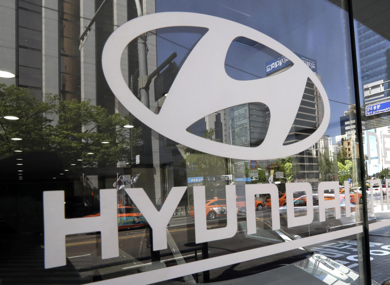<p> FILE - In this Wednesday, April 26, 2017, file photo, the logo of Hyundai Motor Co. is displayed at the automaker's showroom in Seoul, South Korea. Hyundai Motor Group on Wednesday says it has signed an agreement with Audi AG to jointly develop electronics vehicles powered by fuel cell. (AP Photo/Lee Jin-man, File) </p>
