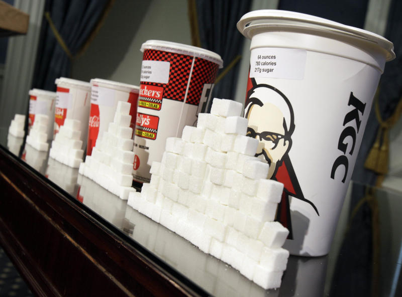 Various size cups and sugar cubes  are displayed at a news conference at New York's City Hall, Thursday, May 31, 2012. New York Mayor Michael Bloomberg is proposing a ban on the sale of large sodas and other sugary drinks in the city's restaurants, delis and movie theaters in the hopes of combating obesity, an expansion of his administration's efforts to encourage healthy behavior by limiting residents' choices. (AP Photo/Richard Drew)