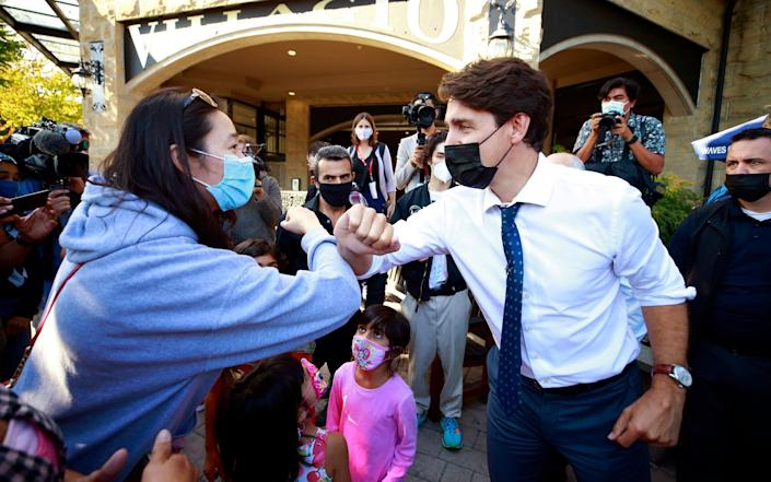 Canadian Prime Minister and Liberal leader Justin Trudeau greets a constituent during a campaign stop in Port Coquitlam, Canada - Jeff Vinnick/Getty