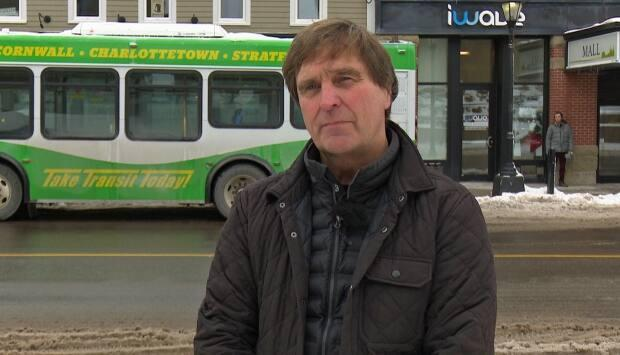 Mike Cassidy, owner of T3 Transit, says new signs have been added to the backs of buses to remind motorists of a new yield-to-buses rule. (Julien Lecacheur/Radio Canada - image credit)