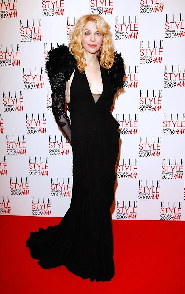 "Rocker Courtney Love struck a pose in a black Givenchy Couture gown upon arriving at the ELLE Style Awards in London. Jon Furniss/<a href=""http://www.wireimage.com"" target=""new"">WireImage.com</a> - February 9, 2009"