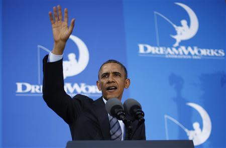 U.S. President Barack Obama waves after speaking to workers on the economy at DreamWorks Animation in Glendale, California, November 26, 2013. REUTERS/Jason Reed