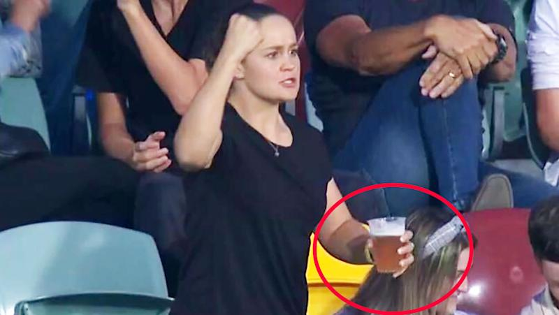 Ash Barty, pictured here enjoying a beer at the AFL.