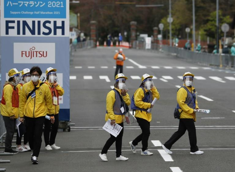 Officials wore protective masks and face shields