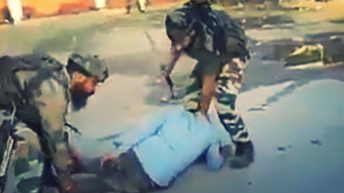 More Videos of Personnel Beating Youth in Kashmir Emerge