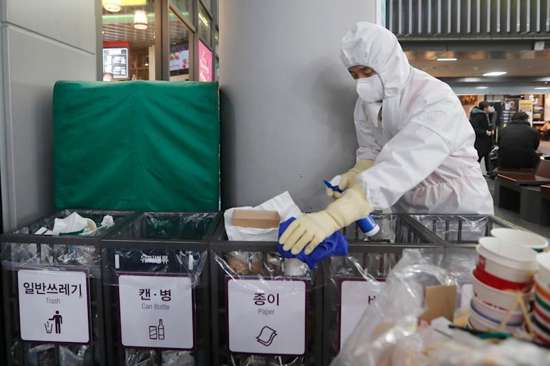 An employee works to prevent a new coronavirus at Suseo Station in Seoul on Friday. (Photo: ASSOCIATED PRESS)