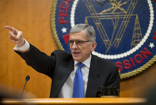 Federal Communications Commission (FCC) Chairman Tom Wheeler gestures as he speaks during an open hearing in Washington, Thursday, Feb. 26, 2015. The FCC votes on a plan that would require Internet providers like Comcast, Verizon AT&T and others to act in the public interest when providing a mobile connection to your home or phone. The industry is widely expected to go to court to find the regulation, once approved. (AP Photo/Pablo Martinez Monsivais)