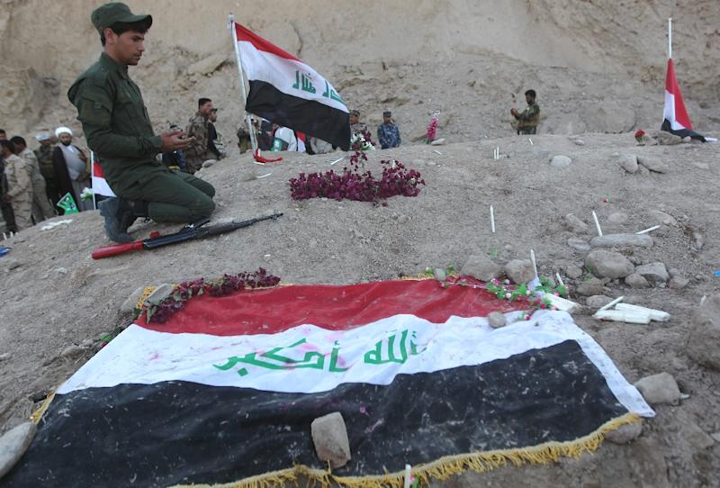 The Speicher massacre -- named after the nearby base from which hundreds of Shiite recruits were abducted in 2014 -- stoked widespread anger against the Islamic State (IS) state and helped rally support to battle the jihadists (AFP Photo/Ahmad al-Rubaye)
