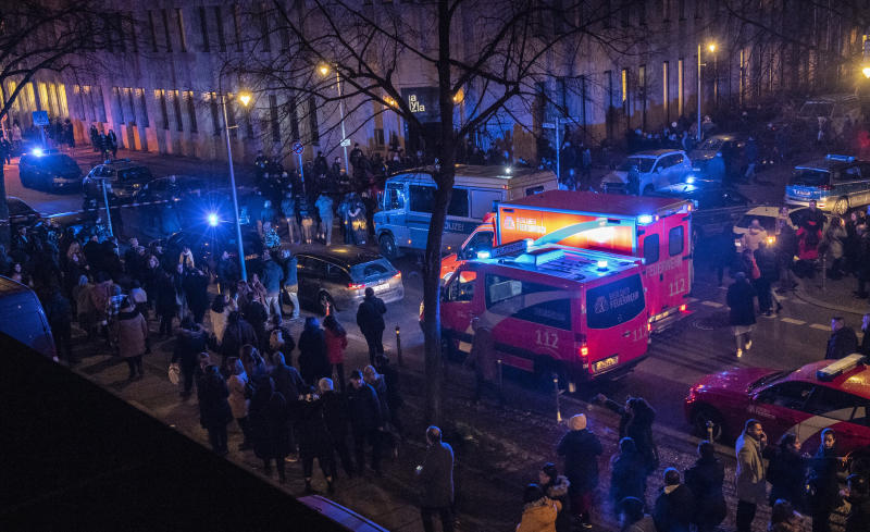 Police and emergency cars stand in a crowed near the Tempodrom venue after a shooting in Berlin, Germany, early Saturday, Feb. 15, 2020. According to police one person was killed. (Paul Zinken/dpa via AP)
