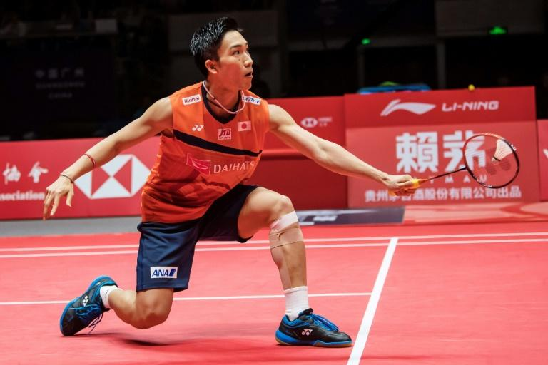 Kento Momota fought back from a game down to win his 11th badminton title of the year with victory at the BWF World Tour Finals