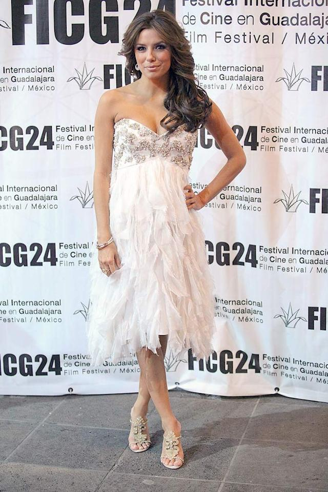 "Eva Longoria wowed the crowd at the Guadalajara International Film Festival in a white Badgley Mischka Spring '09 dress complete with a bedazzled bodice and shredded skirt. Victor Chavez/<a href=""http://www.wireimage.com"" target=""new"">WireImage.com</a> - March 21, 2009"