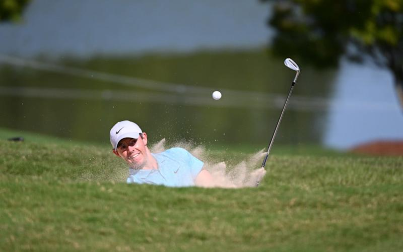 Rory McIlroy hits from a sand trap on the 9th green during the third round of the Tour Championship golf tournament at East Lake Golf Club - USA TODAY Sports