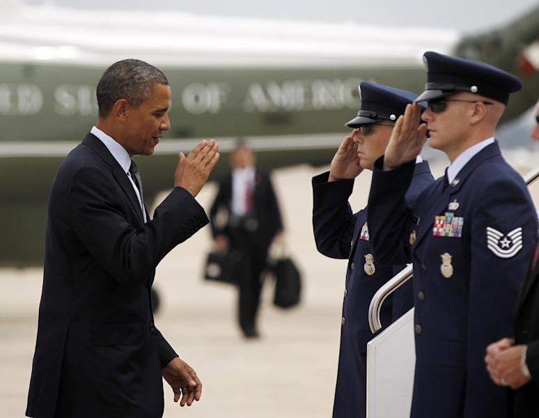 President Barack Obama returns a salute as he prepares to board Air Force One before his departure from Andrews Air Force Base, Md., Wednesday, Aug., 8, 2012. Obama is traveling on a two-day campaign trip to Colorado. (AP Photo/Pablo Martinez Monsivais)