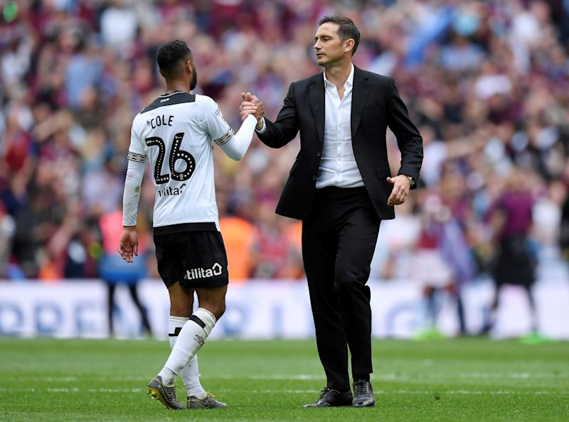 Soccer Football - Championship Playoff Final - Aston Villa v Derby County - Wembley Stadium, London, Britain - May 27, 2019 Derby County manager Frank Lampard shakes hands with Ashley Cole after the match Action Images via Reuters/Tony O'Brien
