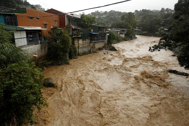 <p>The flooded Tiribi river is seen during heavy rains of Tropical Storm Nate that affects the country in San Jose, Costa Rica, Oct. 5, 2017. (Photo: Juan Carlos Ulate/Reuters) </p>