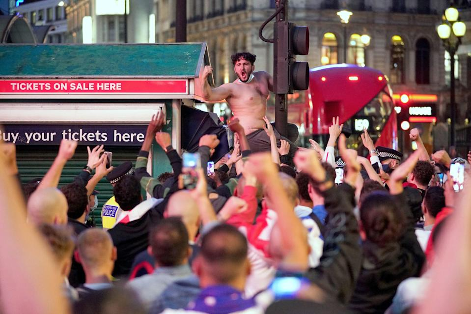 England football fans in Piccadilly Circus, central London, celebrating England's victory over Germany in the Euro 2020 round of 16 match (PA)