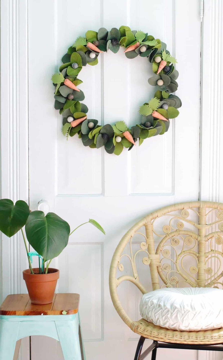 """<p>Here's a wreath any bunny would approve of! For this project, you'll use some sewing skills to craft the carrots, complemented by pretty faux leaves.</p><p><strong>Get the tutorial at <a href=""""https://abeautifulmess.com/spring-wreath-diy/"""" rel=""""nofollow noopener"""" target=""""_blank"""" data-ylk=""""slk:A Beautiful Mess"""" class=""""link rapid-noclick-resp"""">A Beautiful Mess</a>.</strong></p><p><a class=""""link rapid-noclick-resp"""" href=""""https://go.redirectingat.com?id=74968X1596630&url=https%3A%2F%2Fwww.walmart.com%2Fsearch%2F%3Fquery%3Dhot%2Bglue%2Bguns&sref=https%3A%2F%2Fwww.thepioneerwoman.com%2Fhome-lifestyle%2Fcrafts-diy%2Fg35698457%2Fdiy-easter-wreath-ideas%2F"""" rel=""""nofollow noopener"""" target=""""_blank"""" data-ylk=""""slk:SHOP HOT GLUE GUNS"""">SHOP HOT GLUE GUNS</a></p>"""
