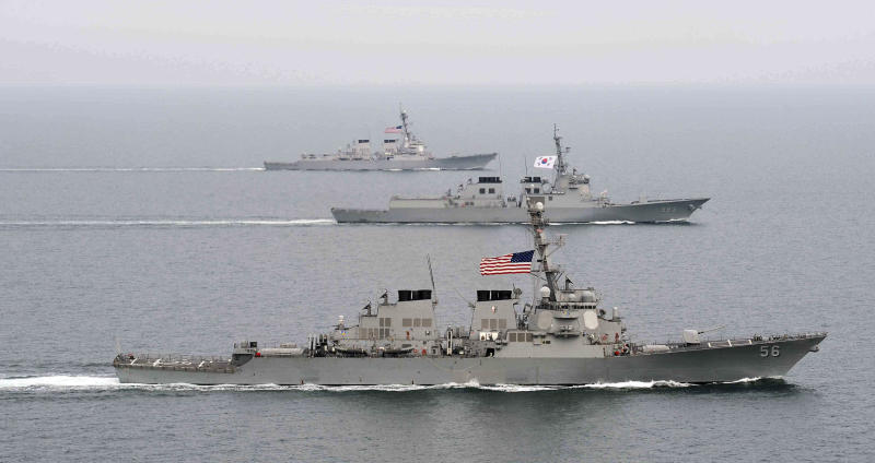 """FILE - In this March 17, 2013 file photo released by the South Korean Navy via Yonhap on March 18, 2013, South Korea and U.S. warships participate in their joint military drill """"Foal Eagle"""" in South Korea's West Sea. In its latest account of national defense efforts, China said Tuesday, April 16, 2013,  that the United States is destabilizing the Asia-Pacific region by strengthening its military alliances and sending more ships, planes, and troops to the area. (AP Photo/South Korea Navy via Yonhap, File) KOREA OUT"""