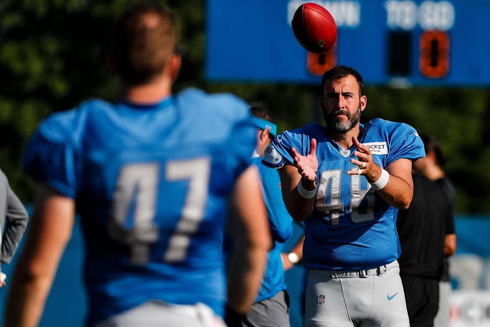 Detroit Lions long snapper Don Muhlbach (48) catches a ball during training camp at the practice facility in Allen Park, Wednesday, Aug. 4, 2021.