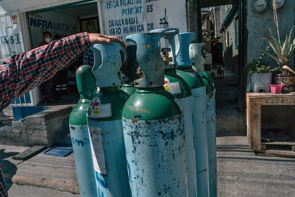 Empty oxygen tanks outside an uncertified private oxygen provider in Mexico City on Wednesday, Feb. 3, 2021. With hospitals overrun, Mexicans fighting the coronavirus at home face a deadly hurdle: a lack of oxygen tanks. (Luis Antonio Rojas/The New York Times)