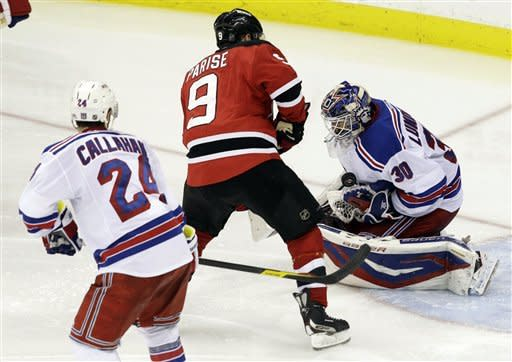 New York Rangers goalie Henrik Lundqvist (30), of Sweden, tries to control the puck as New Jersey Devils' Zach Parise (9) approaches during the third period of Game 4 of an NHL hockey Stanley Cup Eastern Conference final playoff series, Monday, May 21, 2012, in Newark, N.J. Rangers' Ryan Callahan is at left. (AP PhotoKathy Willens)