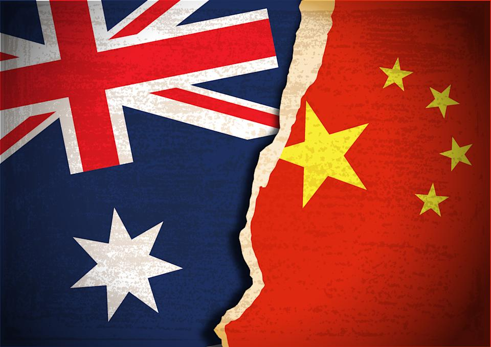 Vector of Conflict concept of Australian and Chinese flag background. EPS Ai 10 file format.