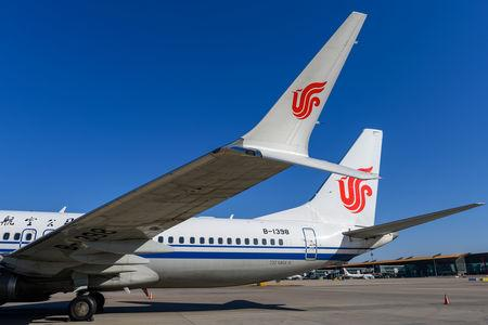 A Boeing 737 MAX 8 aircraft of Air China sits on the tarmac at an airport in Beijing, China March 11, 2019.  REUTERS/Stringer/Files