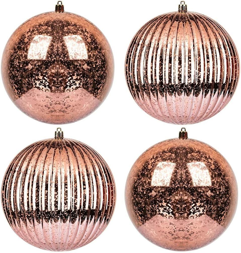 <p>If you love the look of mercury glass, these <span>KI Store Rose Gold Christmas Ball Ornaments</span> ($22) are perfect. </p>