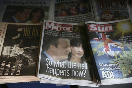 Newspapers are displayed for sale the day after Britain voted to leave the EU, at a newsagents in central London