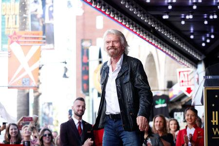 Branson waits before unveiling his star on the Hollywood Walk of Fame in Los Angeles