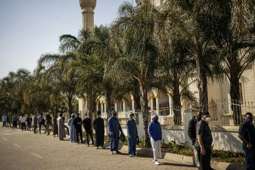 Worshippers wearing facemasks attended Friday prayers at Johannesburg's Nizamiye Mosque after the government said religious services could resume from June 1