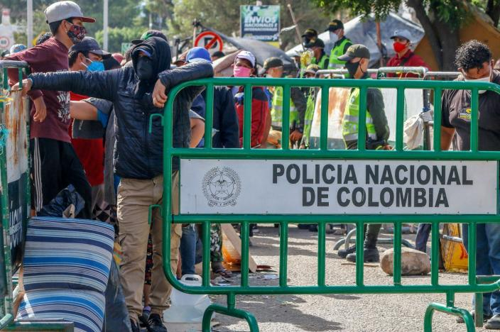 "<span class=""caption"">Venezuelans wait at the Colombian border to be processed and housed in tents in 2020. All Venezuelans now in Colombia will receive a 10-year residency permit.</span> <span class=""attribution""><a class=""link rapid-noclick-resp"" href=""https://www.gettyimages.com/detail/news-photo/venezuelans-queue-as-they-are-being-transferred-from-the-news-photo/1219988930?adppopup=true"" rel=""nofollow noopener"" target=""_blank"" data-ylk=""slk:Schneyder Mendoza/AFP via Getty Images"">Schneyder Mendoza/AFP via Getty Images</a></span>"