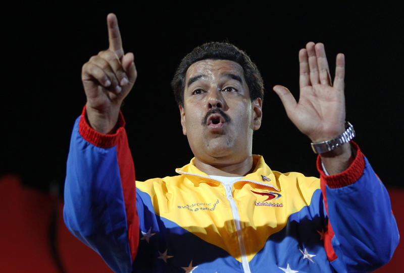 Venezuela's interim President Nicolas Maduro gestures while interacting with supporters during a campaign rally in Valencia. Venezuela, Thursday, April 4, 2013. The presidential election to replace Venezuela's late President Hugo Chavez is scheduled for April 14. (AP Photo/Ariana Cubillos)