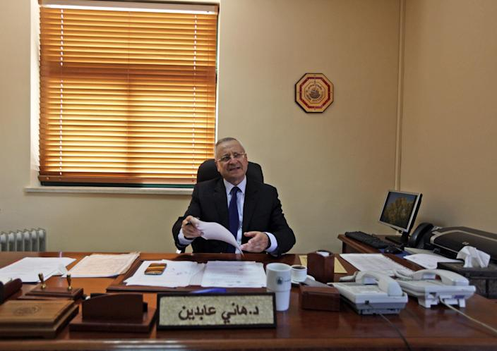 In this Wednesday, April 9, 2014 photo, Palestinian Hani Abdeen, Dean of the Faculty of Medicine, reviews papers in his office at the Al-Quds University in the West Bank village of Abu Dis, near Jerusalem. Dozens of Palestinian doctors who graduated from Al-Quds University, a school that has a foothold in east Jerusalem, are caught in the political battle between Israel and the Palestinians over the city's eastern sector. Israel has refused to recognize the university's graduates -- a move that could amount to acknowledging the Palestinian claims to east Jerusalem as their capital. (AP Photo/Majdi Mohammed)