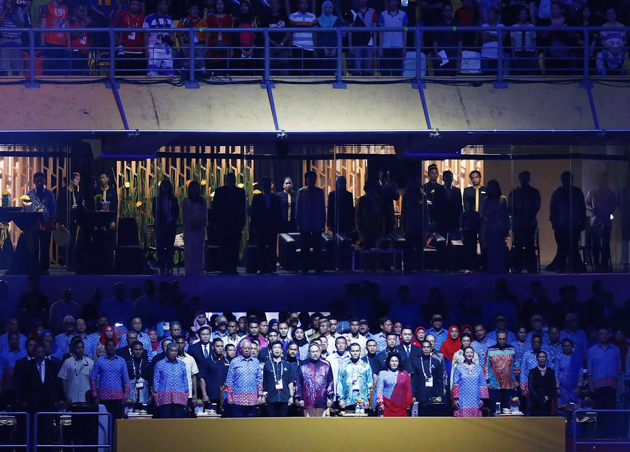 <p>Malaysia's Prime Minister Najib Razak and his wife Rosmah stand as Malaysia's king, Sultan Muhammad V, arrives at the Bukit Jalil National Stadium on Saturday (19 August). (PHOTO: Reuters) </p>