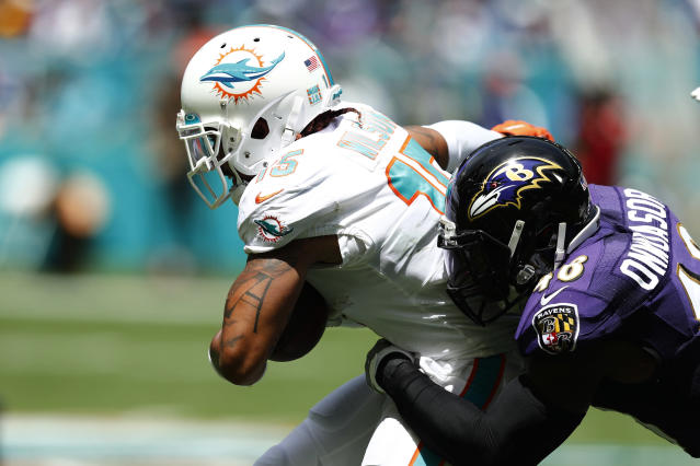 FILE - In this Sept. 8, 2019, file photo, Miami Dolphins wide receiver Albert Wilson (15) is tackled by Baltimore Ravens inside linebacker Patrick Onwuasor (48), during the first half at an NFL football game in Miami Gardens, Fla. The new man in the middle of the Ravens defense is Patrick Onwuasor, who arrived in the NFL as an undrafted free agent and carries the not-so-fearsome nickname Peanut. Playing the position formerly held by Ray Lewis and C.J. Mosley, Onwuasor wore the headset anointed to the leader of the defense and performed precisely as expected in the opener against Miami last Sunday. He led the Ravens with five tackles, had one of the teams three sacks and keyed a unit that allowed just 21 yards rushing in a 59-10 victory.(AP Photo/Brynn Anderson, File)