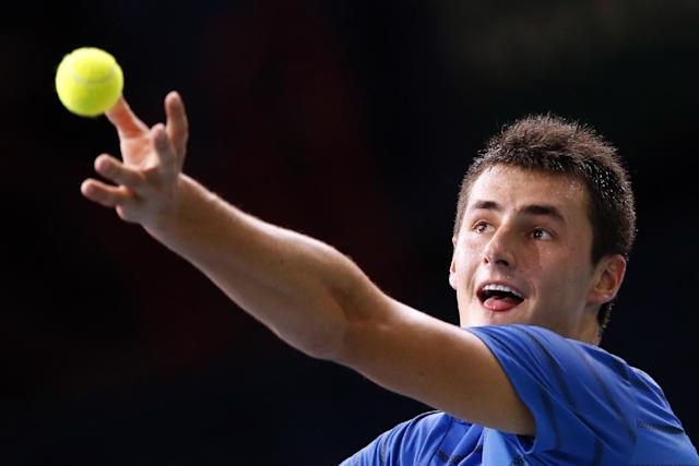 Bernard Tomic of Australia serves to Feliciano Lopez of Spain during the BNP Masters indoor tennis tournament at Bercy Arena in Paris, France, Monday, Oct. 28, 2013. (AP Photo/Francois Mori)