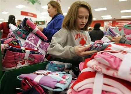 """Shoppers look through a bin full of pajamas inside a Target store on the shopping day dubbed """"Black Friday"""" in Torrington, Connecticut November 25, 2011. REUTERS/Jessica Rinaldi"""