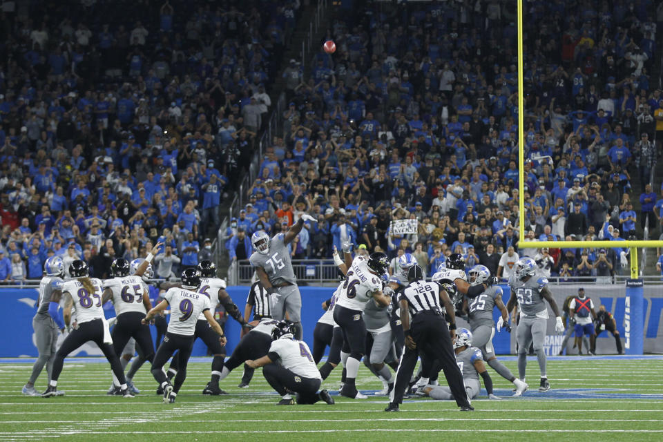 Baltimore Ravens kicker Justin Tucker (9) kicks a 66-yard field goal in the second half of an NFL football game against the Detroit Lions in Detroit, Sunday, Sept. 26, 2021. Baltimore won 19-17. (AP Photo/Tony Ding)