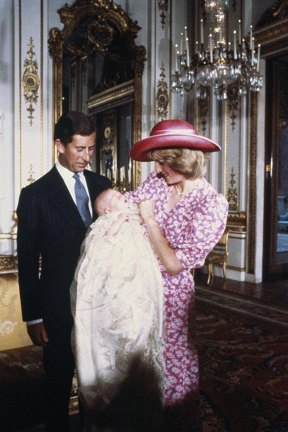 <p>In a pink floral dress and pink hat at the christening of Prince William in the music room at Buckingham Palace. </p>