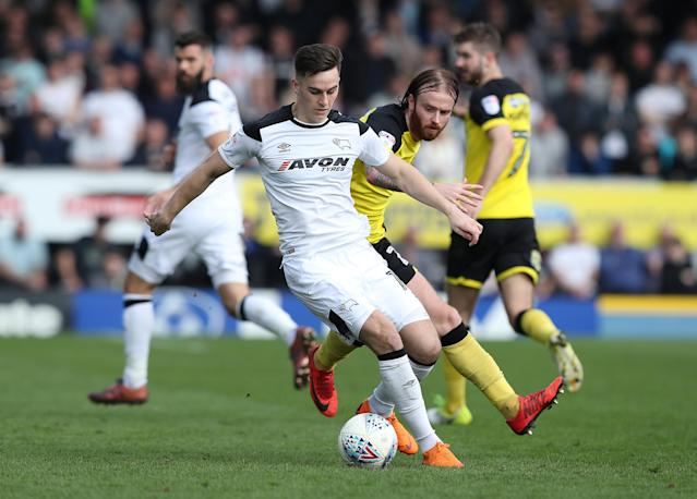 "Soccer Football - Championship - Burton Albion vs Derby County - Pirelli Stadium, Burton-on-Trent, Britain - April 14, 2018 Derby County's Tom Lawrence in action with Burton Albion's John Brayford Action Images/John Clifton EDITORIAL USE ONLY. No use with unauthorized audio, video, data, fixture lists, club/league logos or ""live"" services. Online in-match use limited to 75 images, no video emulation. No use in betting, games or single club/league/player publications. Please contact your account representative for further details."