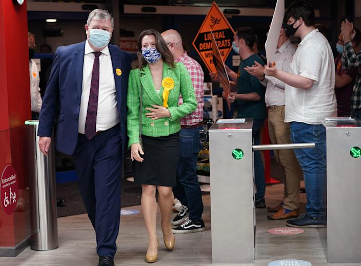 Liberal Democrat candidate Sarah Green and Alistair Carmichael, Liberal Democrat MP for Orkney and Shetland, are greeted by party supporters upon arriving for the declaration (PA)
