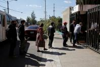 Members of Guatemalan Maya families, who feared their relatives were among 19 bodies found shot and burnt at the weekend in a remote part of northern Mexico, arrive at the Faculty of Medicine for DNA samples to help in the identification, in Guatemala City