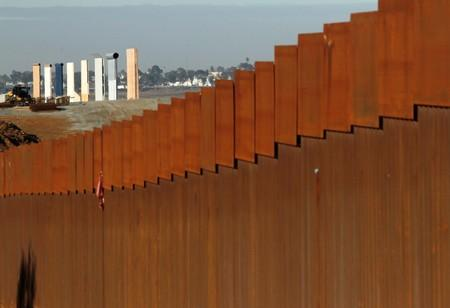 FILE PHOTO - The prototypes for U.S. President Donald Trump's border wall are seen behind the border fence between Mexico and the United States, in Tijuana