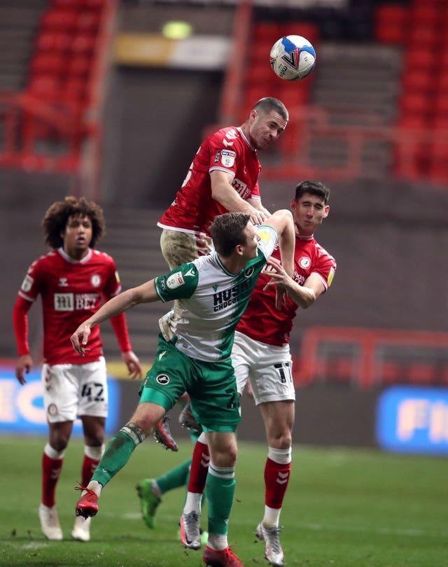 Bristol City's Tommy Rowe rises highest to win a header during his side's Championship match against Millwall