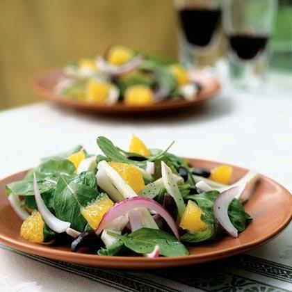 "<p>Blood oranges add vibrant red color, so use them if you can find them. Pit the olives by crushing with the blade of a chef's knife. </p><p><a href=""https://www.myrecipes.com/recipe/orange-arugula-kalamata-olive-salad"">Orange, Arugula, and Kalamata Olive Salad Recipe</a></p>"