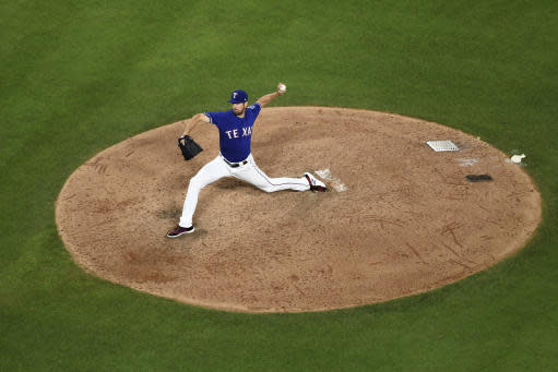 Texas Rangers starting pitcher Cole Hamels works against the New York Yankees during the seventh inning of a baseball game Tuesday, May 22, 2018, in Arlington, Texas. Texas won 6-4. (AP Photo/Jeffrey McWhorter)