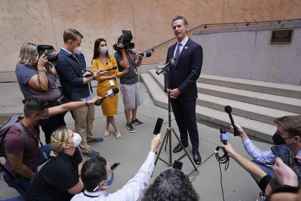 """California Gov. Gavin Newson responds to a question while meeting with reporters after casting his recall ballot at a voting center in Sacramento, Calif., Friday, Sept. 10, 2021. The last day to vote in the recall election is Tuesday, Sept. 14. A majority of voters must mark """"no"""" on the recall to keep Newsom in office. (AP Photo/Rich Pedroncelli)"""