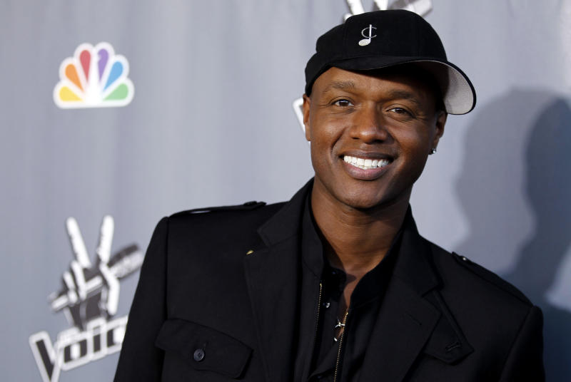 """FILE - In this June 29, 2011 file photo, Javier Colon, winner of the first season of the singing competition series """"The Voice,"""" poses for photographers after the finale in Burbank, Calif. More than a year after his win, Colon is among the rapidly increasing number of reality singing contest winners who didn't go on to fame and fortune. Even as these shows proliferate the number of breakout stars from their ranks has dwindled. (AP Photo/Matt Sayles, File)"""